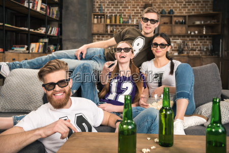 happy young friends in 3d glasses