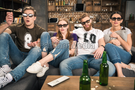 shocked young friends in 3d glasses