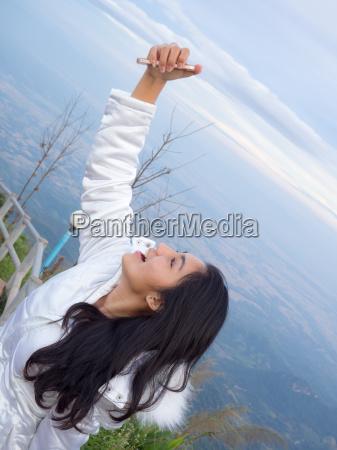 asian woman take a photo on