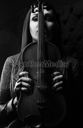girl holds a violin in hands