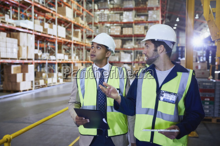 manger and worker with clipboard and