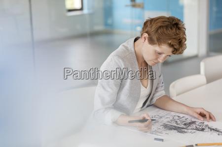 female designer drawing sketch in office