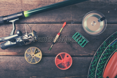 fishing equipment on old wooden table