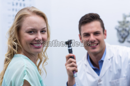 female patient smiling with optometrist in