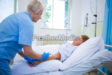 nurse giving an injection to a