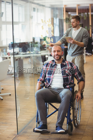smiling handicap businessman in creative office