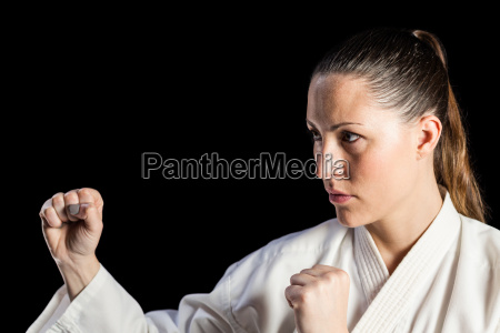 female fighter performing karate stance