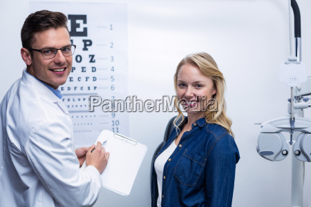 optometrist discussing eye test report with
