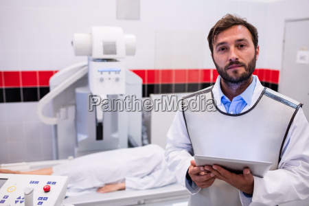 doctor holding digital tablet and patient