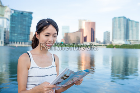 woman using paper map in macao