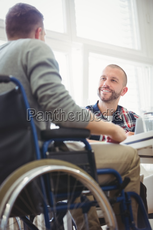 handicap businessman with colleague in creative