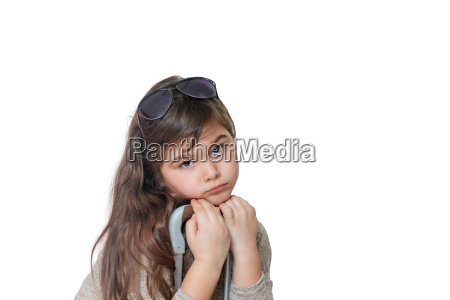 sad little girl is leaning on
