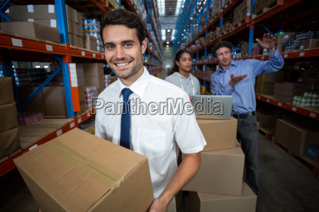 focus of manager holding cardboard box