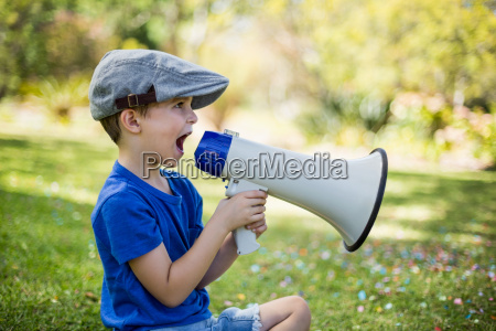 young boy speaking on megaphone