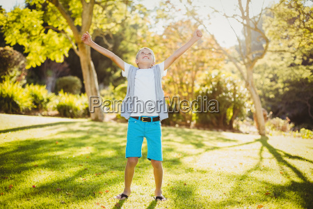 excited young boy in park