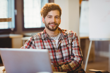 portrait of graphic designer working on