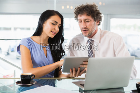 businessman discussing with colleague over digital