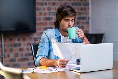 businessman having coffee in office