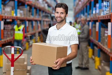 portrait of worker is holding cardboard