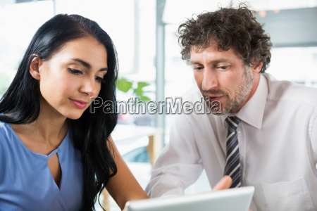 businessman discussing with colleague over laptop