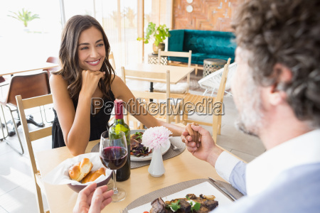 man holding hands of woman