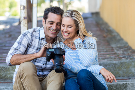 couple looking in camera while sitting
