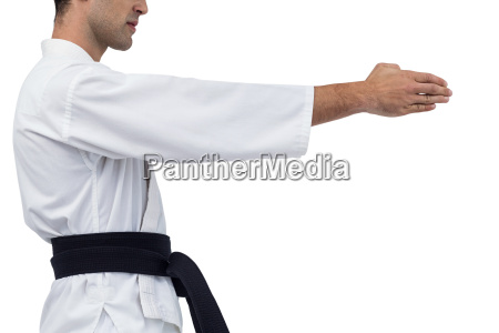mid section of fighter performing karate