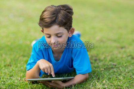 young boy using digital tablet in