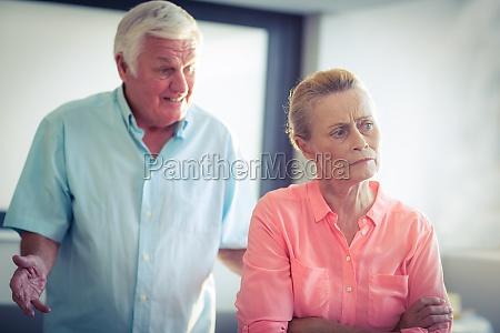 senior woman ignoring a senior man