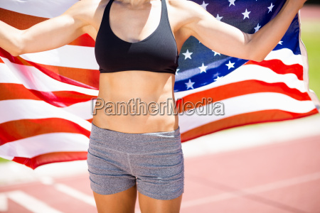 mid section of female athlete holding