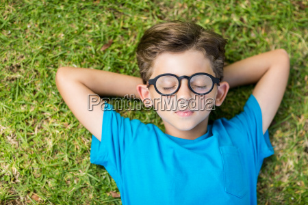 young boy in spectacle sleeping in