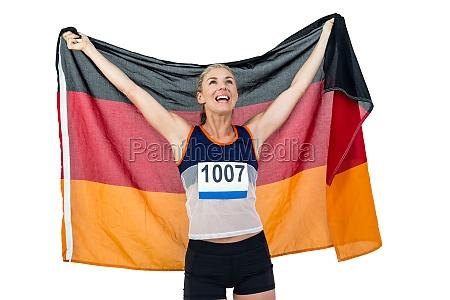athlet mit deutsch flagge nach dem