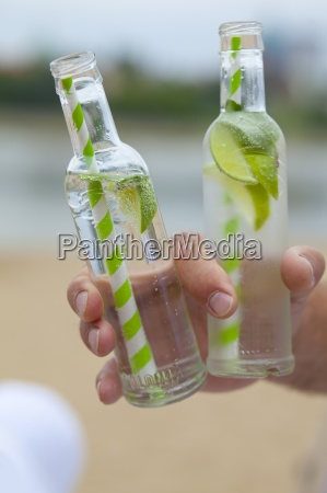 a man holding two bottles of