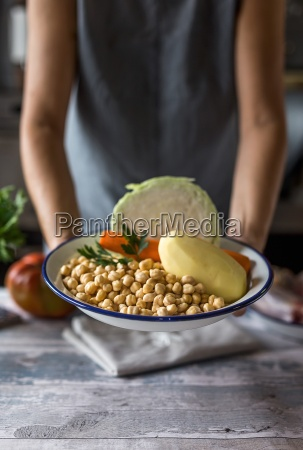 a woman holding a bowl of