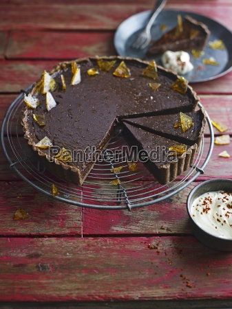 chocolate mousse tart topped with sugar