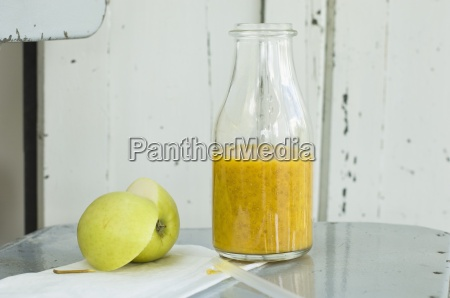 a mango and orange smoothie with