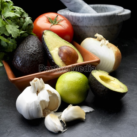 ingredients for guacamole avocado onion tomato