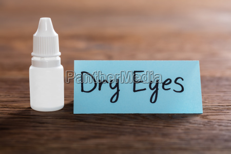dry eyes concept on wooden desk