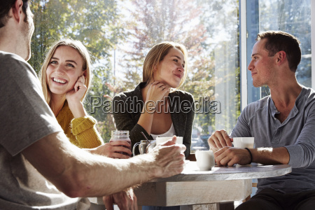 four people sitting at a table
