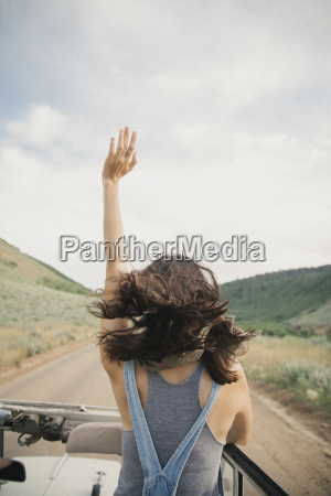a woman with her arm raised