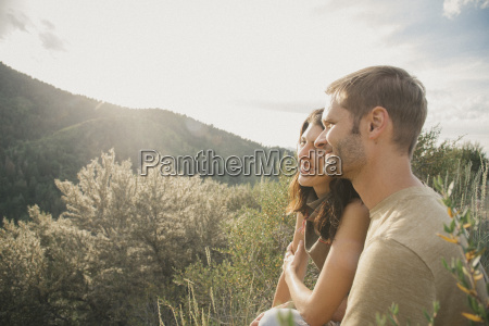 a couple in the mountains standing