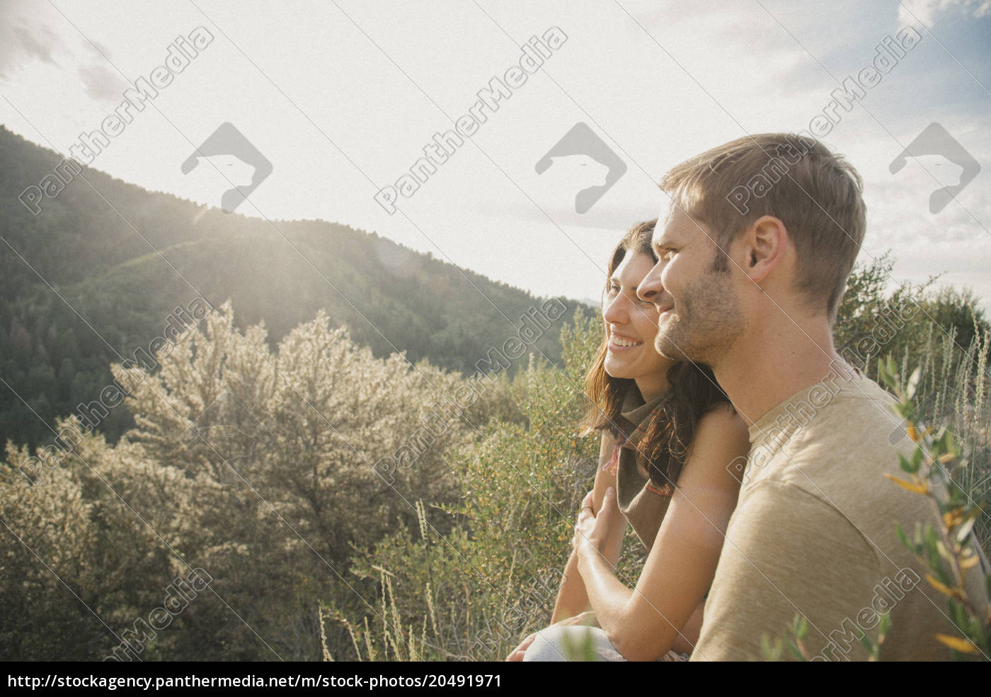 a, couple, in, the, mountains, standing - 20491971