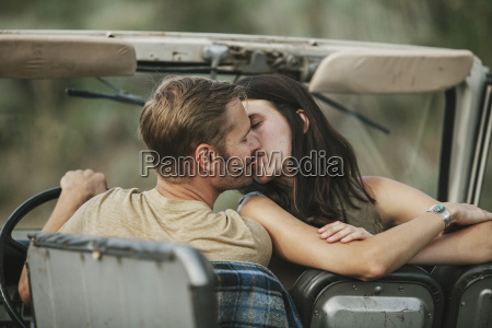 a couple in an open top