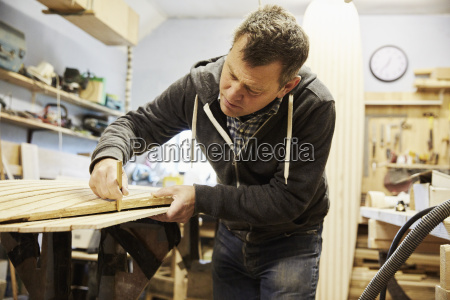 man working on the edge of