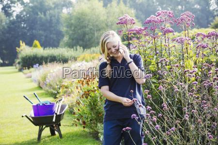 female gardener at waterperry gardens in