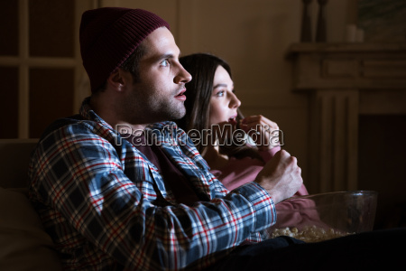 side view of concentrated couple watching