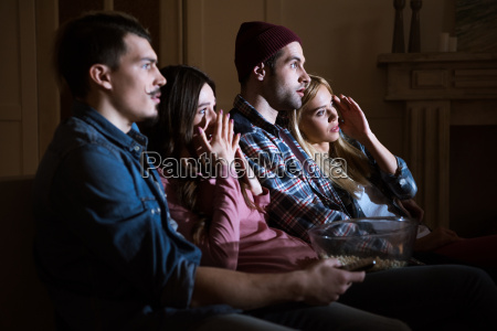 side view of scared friends watching