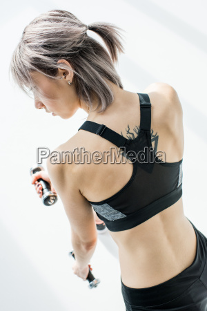 back view of young sporty woman
