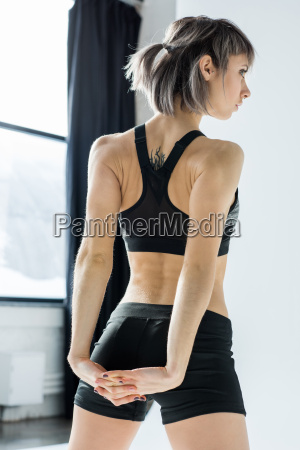 back view of athletic young woman