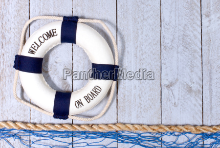 lifebuoy with fishing net on wooden